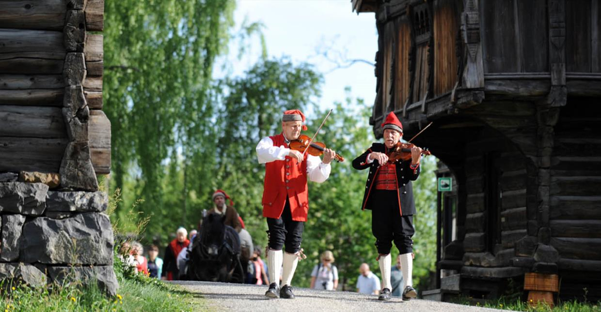 People in national costumes at Maihaugen open air museum
